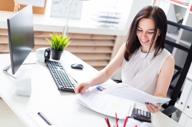 young-girl-sitting-office-computer-desk-working-with-documents-calculator_88135-3958